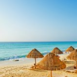 Touristic beach with many umbrellas and sunbeds