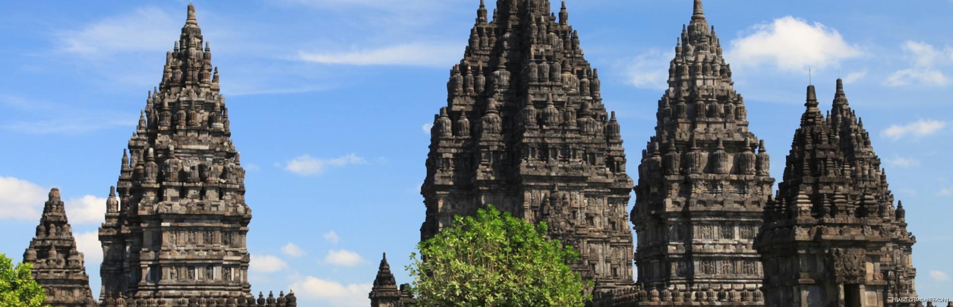 Hindu temple Prambanan seeing behind the leaves