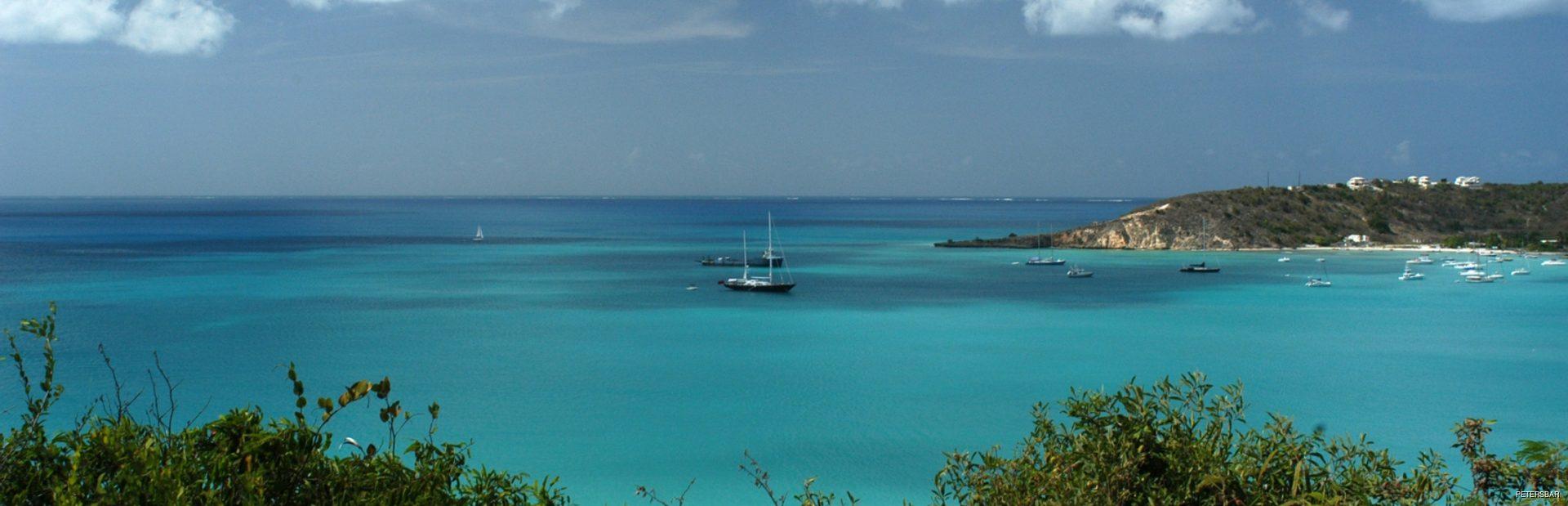 Drifting sailboat on beautiful bay