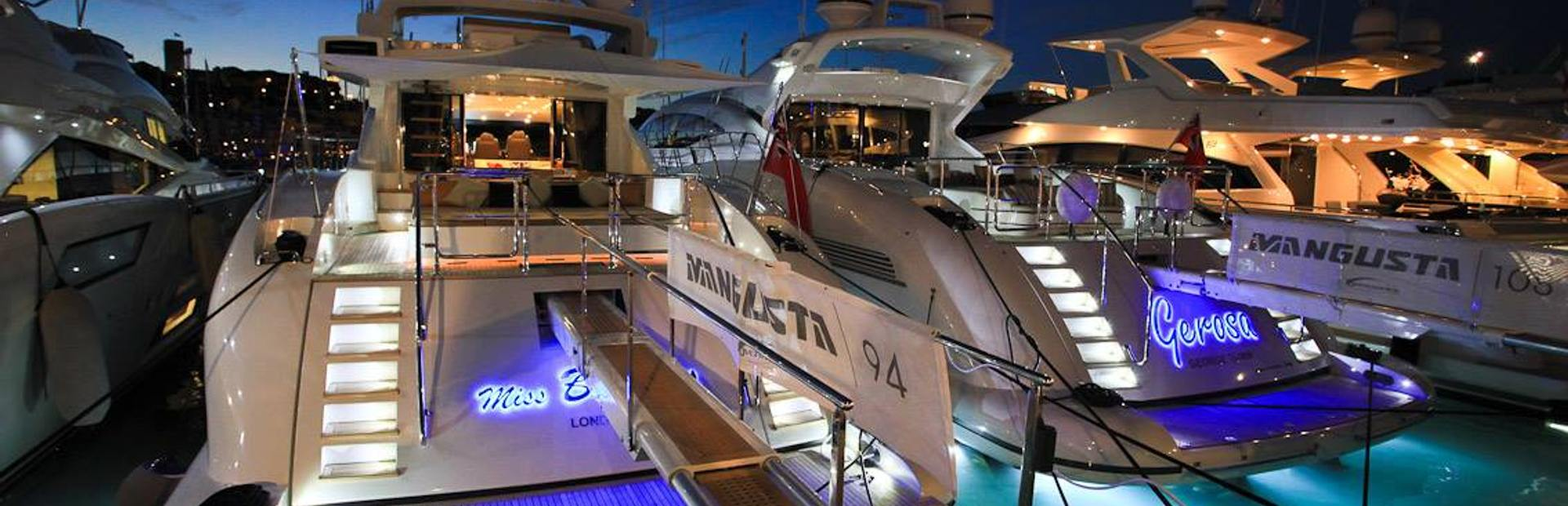 Mangusta Yachts at night Monaco Yacht Show