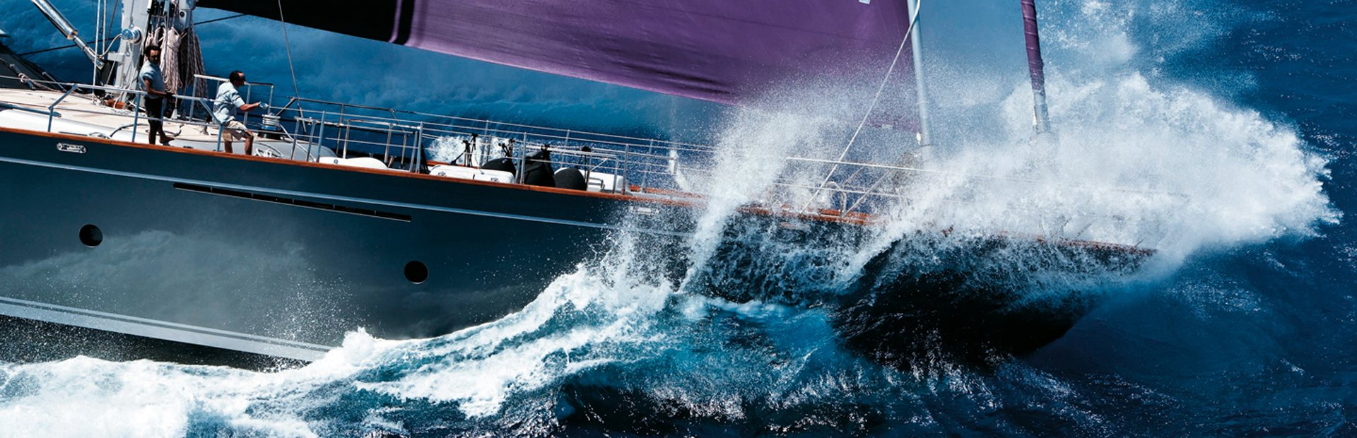 Wave splashing over the bow of yacht in Perini Navi yacht on charter for regatta