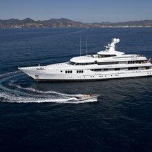 Trident Yacht Running Shot with Tender