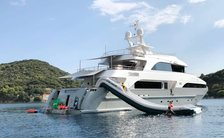 Superyacht Ottawa IV on water with large slide on outside