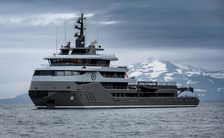 Superyacht RAGNAR on sea with snowcapped hills behind