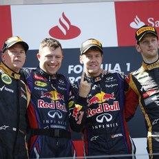 Sebastian Vettel and his team on the podium