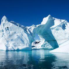 Iceberg bathed in sunlight