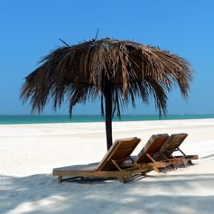Sunbeds with umbrella made from palm leaves