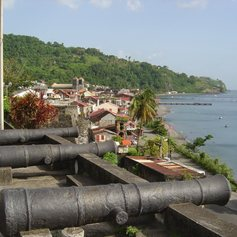 Old cannons pointing on the sea