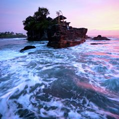 Small rocky island on beautiful rough sea