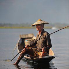 An old fisherman fishing on Inle lake