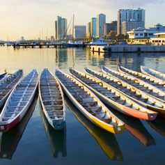 Boats in a row on the background of the city