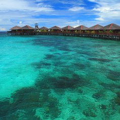 Roofed jetty on turquoise sea
