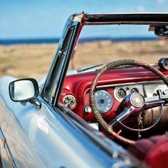 A Classic car on Cuba's seacoast
