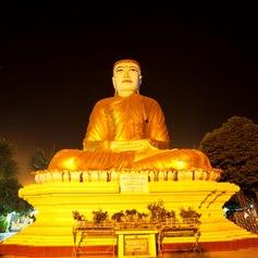 Monumental, lighted Buddhas statue