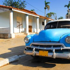 Classic blue car on the road to Vinales
