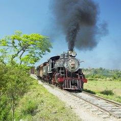 A train rushing through the Cuban countryside