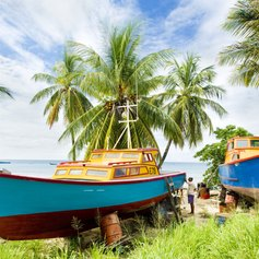 Colourful fishing boats with their owners
