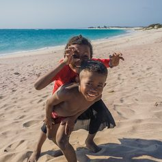 Funny playing children on the beach