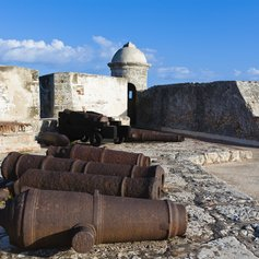 A collection of rusted cannons at a historic Cuban castle