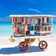 Cart with colourful souvenirs on a Cuban beach