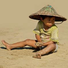 Kid in the hat on the beach