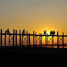 People on the primitive bridge at sunset