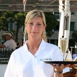 Champagne served onboard luxury superyacht  'One More Toy' during the Monaco Grand Prix weekend. Charter guests have prime viewing of the action taking place on the track right in front of them.