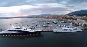Superyachts SYMPHONY and 'Ester III' Tower Over Italy Harbour