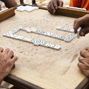Players compete in a game of dominoes in Cuba