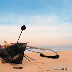 Old fishing boat on empty beach