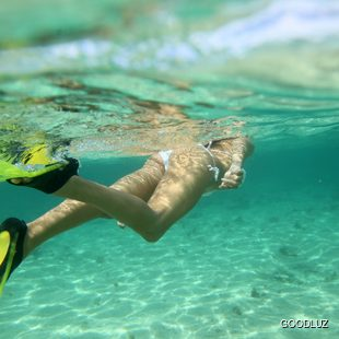 Following woman snorkeler