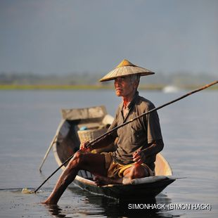 An old fisherman fishing on Inle lake