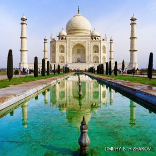 Taj-Mahal mausoleum with big garden visiting by tourists