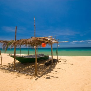 Shade on the beach for fishing boat