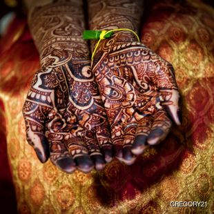 Indian bride presenting her henna tattoos