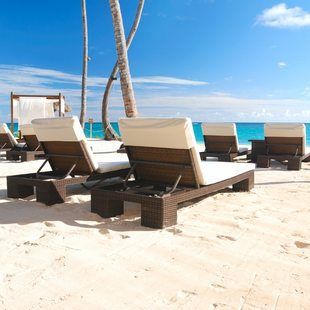 Luxurious wooden sunbeds on the beach