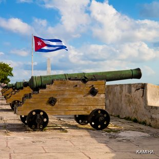 Old cannons with waving Cuban flag