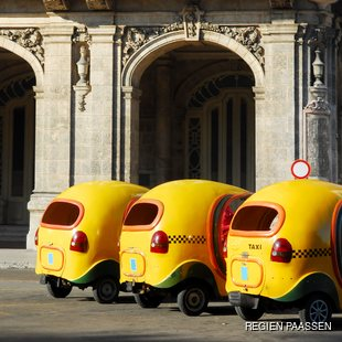 Cocotaxis lined up in Cuba