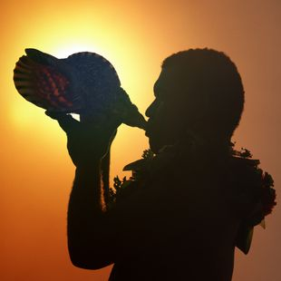 Man with conch shell