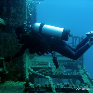 Scuba diver on old ship wreck