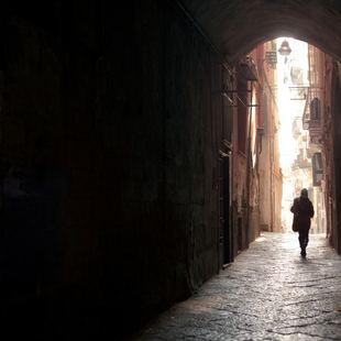 Alone woman under the dark arch