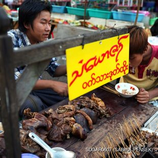 Food stall with beef and pig giblets, entrails in Myanmar