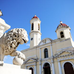 A lion statue outside a classic Cuban building