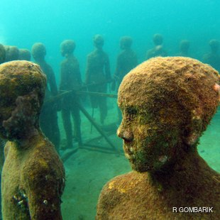 Underwater circle formed by sculptures of children