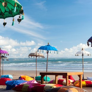 Decorated high umbrellas on the Indonesian beach