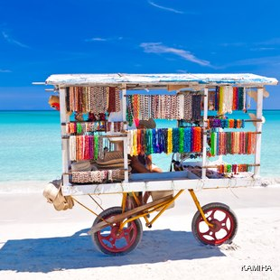 Cart with colourful souvenirs on a Cuban beach