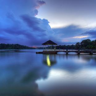 Peaceful scenery of jetty with beautiful cumulous clouds in the background