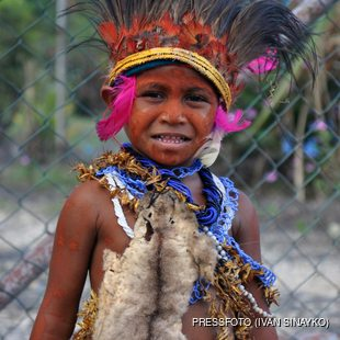 Little boy in traditional Papua New Guinean outfit