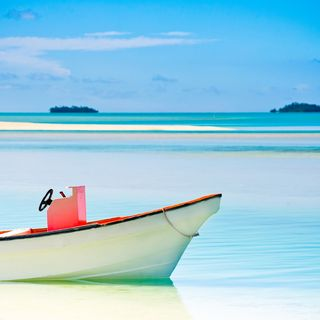 Small boat floating on the sea