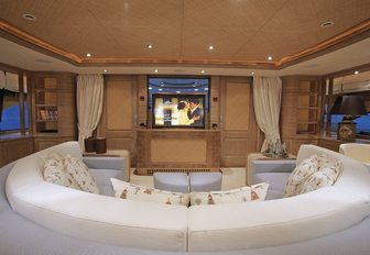 curved sofa and TV in the skylounge aboard motor yacht JO
